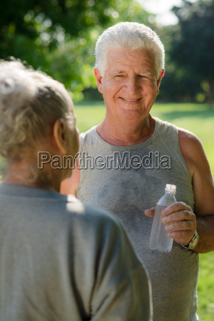 seniors drinking water after fitness in