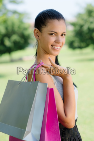 happy young woman smiling with shopping