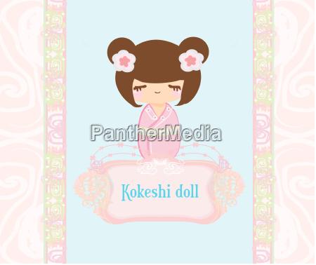 kokeshi puppe auf dem rosa hintergrund
