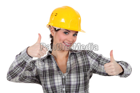 smiling tradeswoman giving two thumbs up