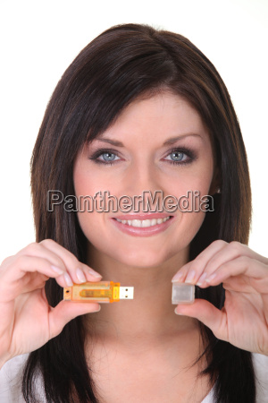 attractive woman showing usb key