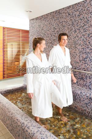 man and woman treading on wellness
