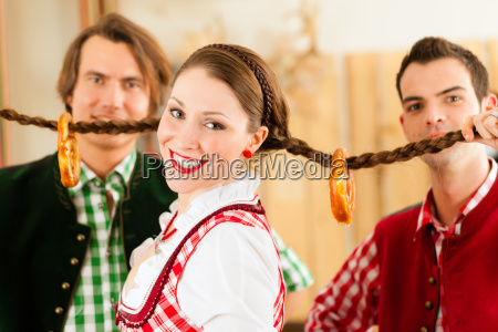 young people in bavarian tracht in