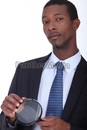 african american man in suit holding