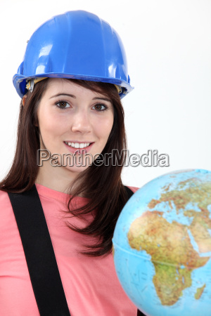 young woman in a hardhat with