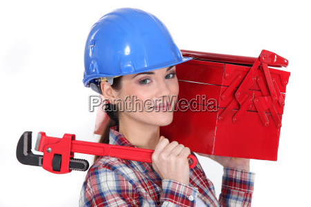 woman holding wrench and tool box