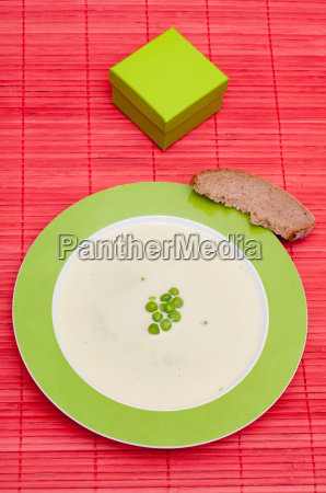 soup with green peas and bread
