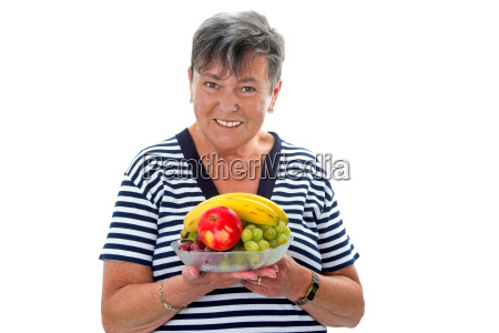 old woman with plate of fruit