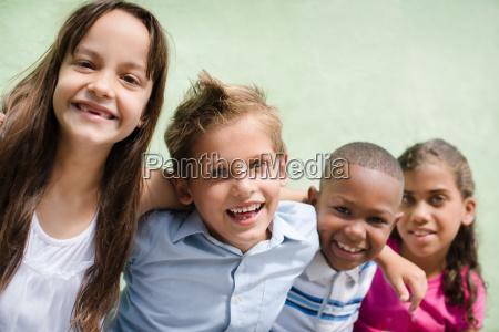 happy children hugging smiling and having
