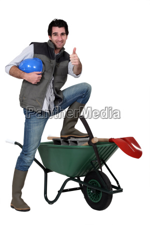 happy building worker isolated on white