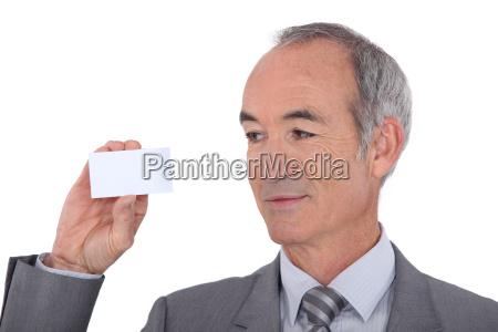 man holding businesscard