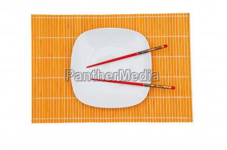 white plate with chopsticks isolated on