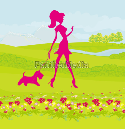 pretty girl walking the dog