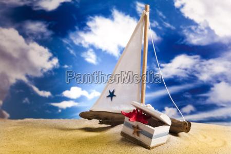 sailboat on sand on beach background