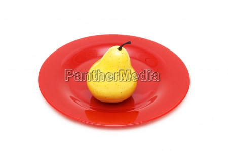 yellow pear and red plate isolated