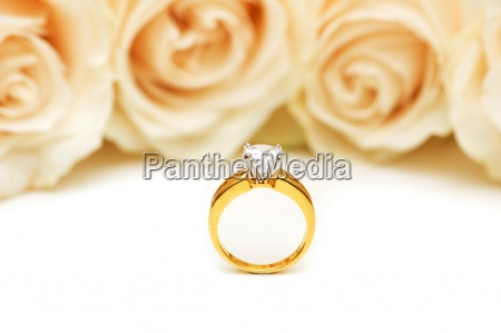 roses and wedding ring isolated on