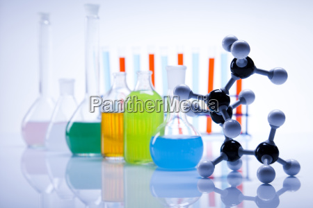 laboratory flasks with fluids of different