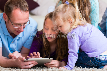 family plays with the tablet computer