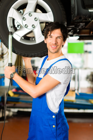 mechanic working on car in workshop