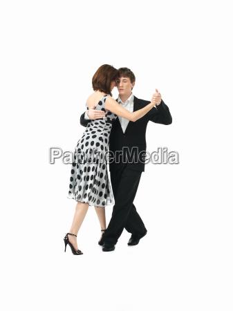 young couple dancing the tango white