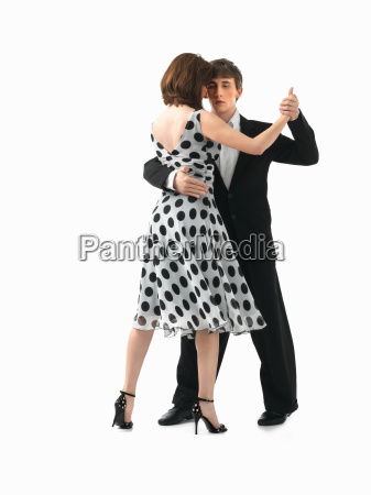 young couple dancing the tango white