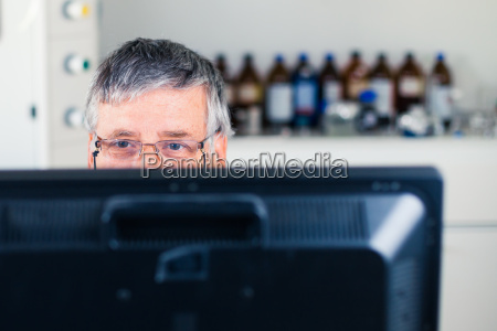 senior researcher using a computer in