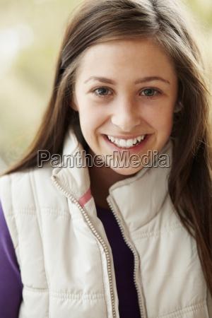 outdoor portrait of teenage girl wearing