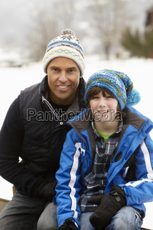 portrait of father and son wearing