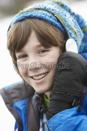 boy wearing headphones and listening to