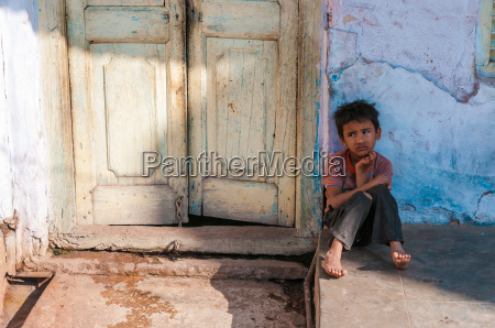 sitting boy in front of a