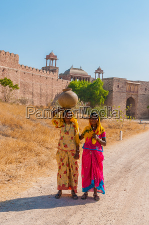 two young indian woman in colorful