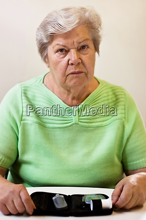 senior woman with worrying eye to