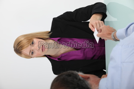woman and man exchanging a business