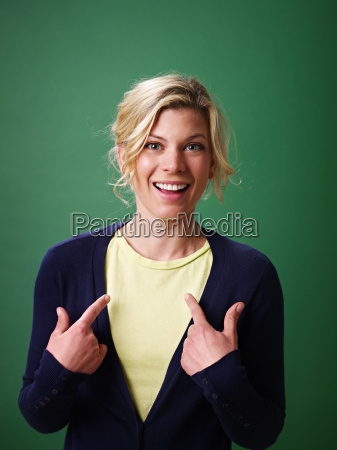 woman pointing at herself studio shot