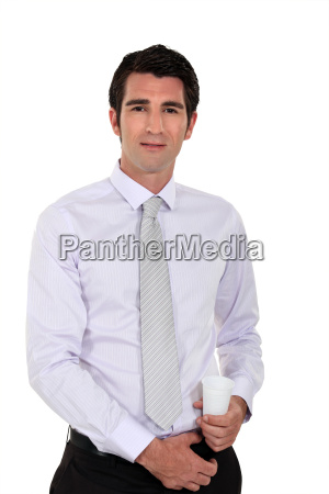 businessman holding a plastic disposable cup