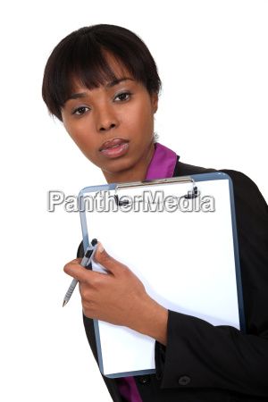 businessman holding clip board and pen