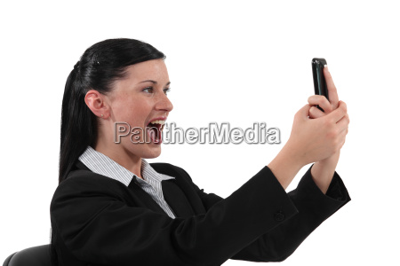 overjoyed woman reading text message