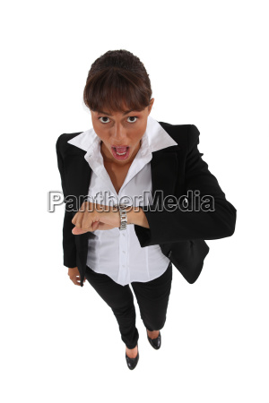 businesswoman shocked by the time