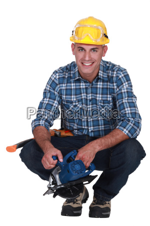 smiling man with a circular saw