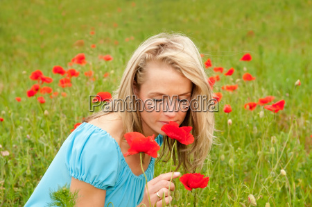 young woman with poppy