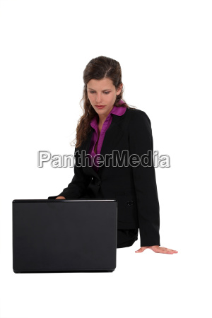 woman in a suit looking at
