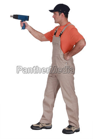 laborer using drill on white background