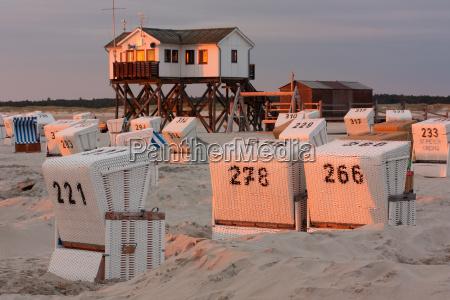 beach chairs and stilt houses on