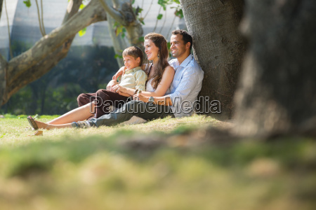 happy family in city gardens relaxing