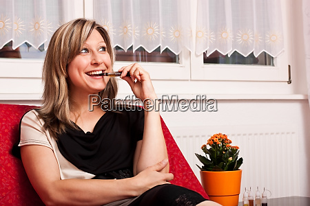 pretty woman sitting on couch and