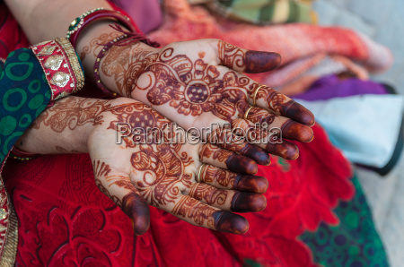 an indian woman with henna tattoos