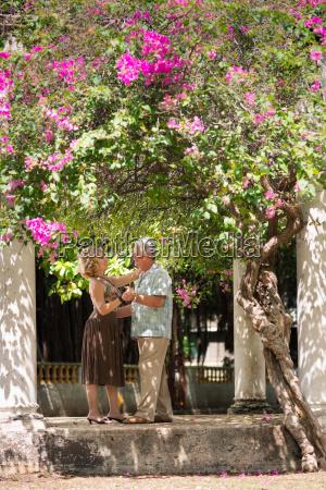 happy senior couple dancing latin american
