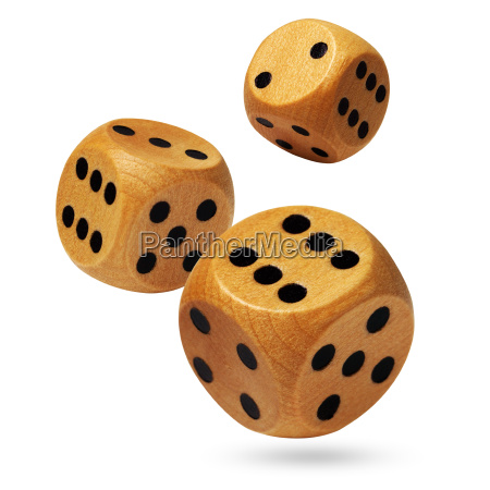 three rolling wooden dices