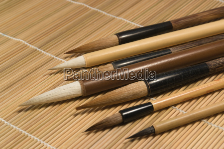 chinese brushes on wooden mat detail