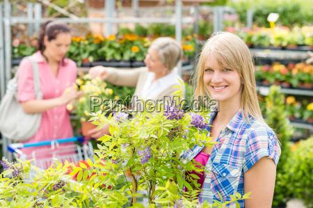 smiling woman at garden centre shopping